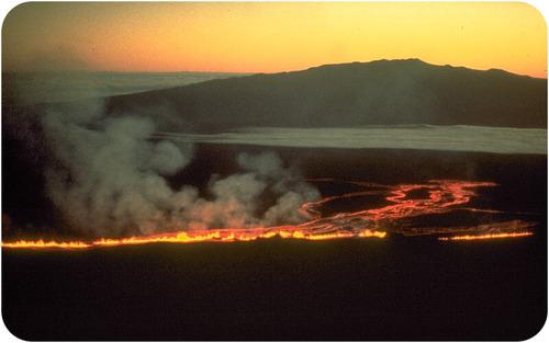 A fissure eruption on Mauna Loa in Hawaii travels toward Mauna Kea on the Big Island