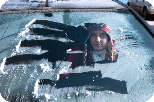 Scraping frost off a windshield