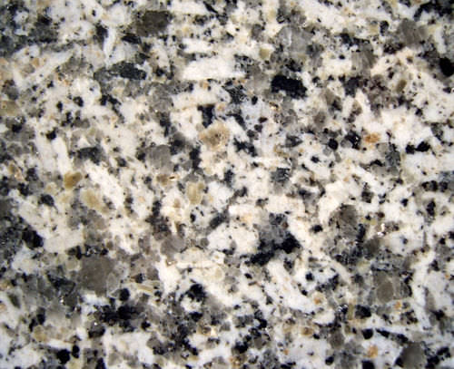 Granite, an intrusive igneous rock, is made of feldspar, quartz, hornblende, and biotite