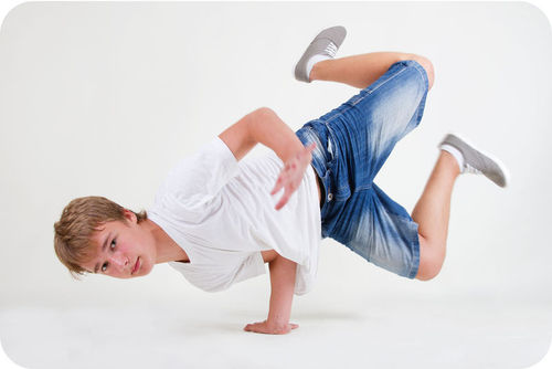 This break-dancer is concentrating his weight on his hand