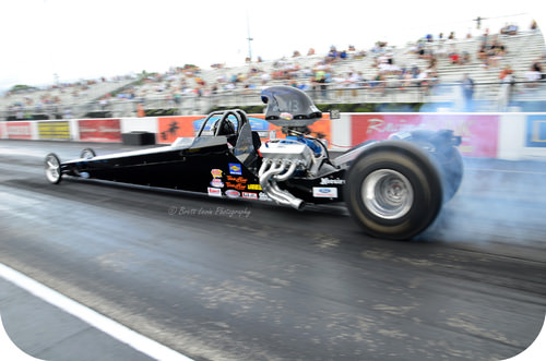 The fuel of a dragster contains large amounts of potential energy