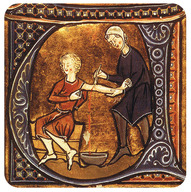 Physician letting blood from a patient.
