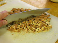 Knife cutting through nuts