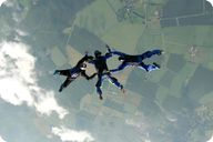 Skydiving is possible because of the law of gravity
