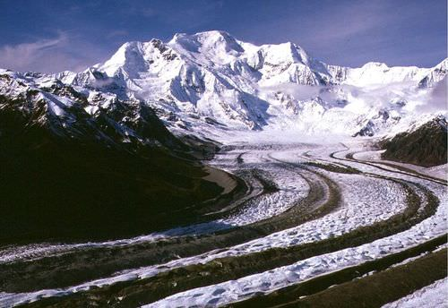 The long, dark lines on a glacier in Alaska are medial and lateral moraines