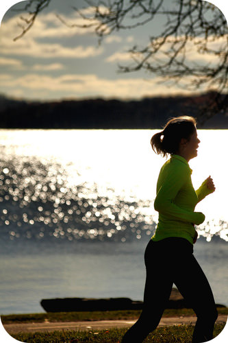 Long distance runners, such as this woman running by the lake, try to keep constant velocity