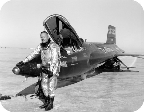 Test Pilot Neil Armstrong is seen standing next to the X-15 ship after a research flight