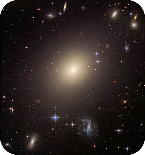 The red-yellow galaxy at the center of this image is an elliptical galaxy