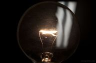 Incandescent lightbulb with glowing filament