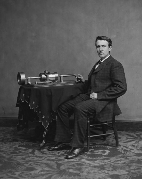 Thomas Edison and an early phonograph.