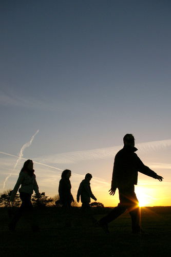 silhouettes of people against the sunset