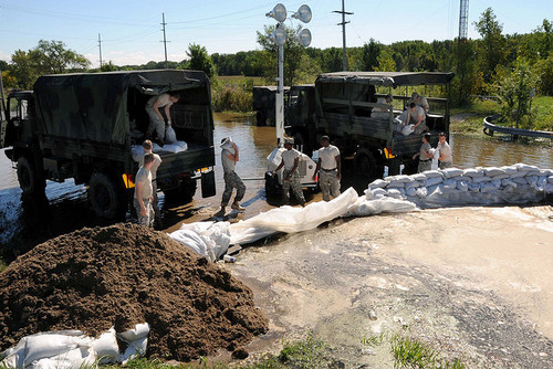 Sandbags create levees to try to stop a flood